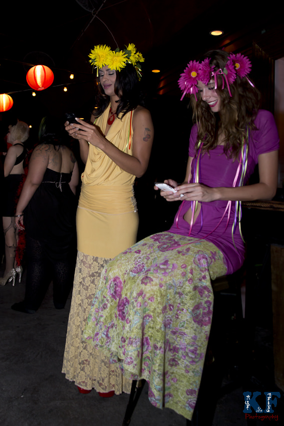 Models, Delila Hart and Kimberley Hall waiting for fashion show to begin, texting their friends to attend the show